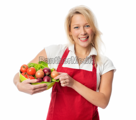 woman with apron presenting a dish