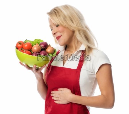 housewife in apron holding a delicious
