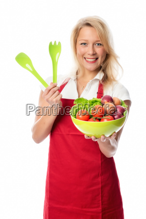 woman with apron presenting a bowl