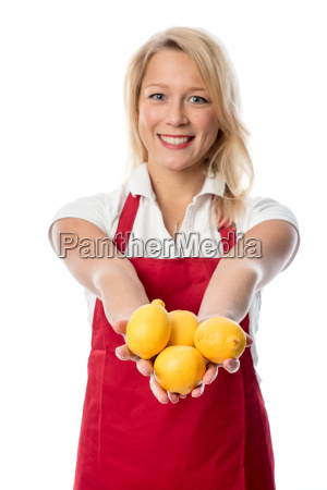 housewife with apron presenting a handful