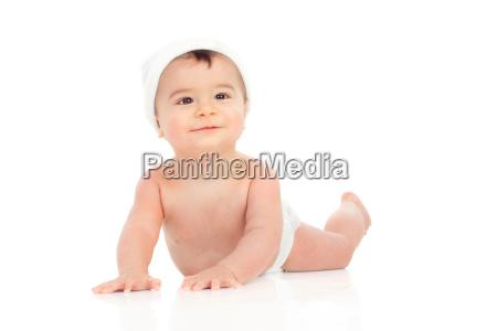cute baby in diaper with cap