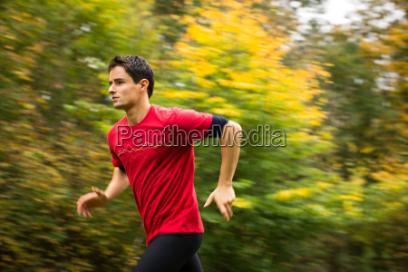 young man running outdoors in a