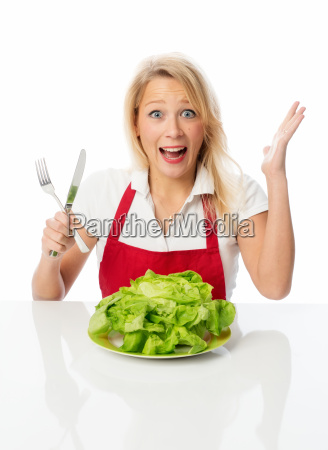 blonde woman with utensils in hand