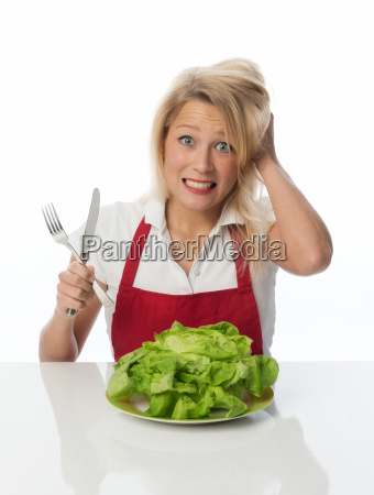 blonde housewife with lettuce contorts her