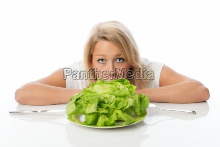 blonde woman presenting a head salad