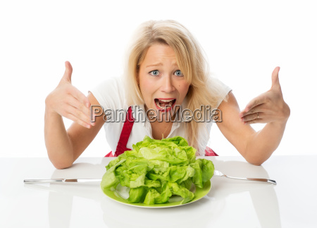 blonde woman presenting a lettuce