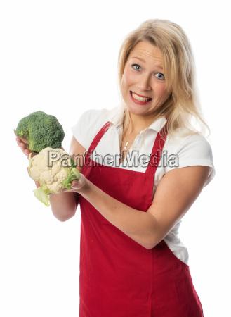 woman holding broccoli and cauliflower