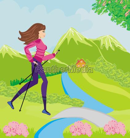 nordic walking aktive frau im