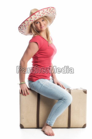 blonde woman with sombrero sitting on