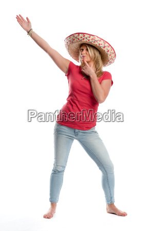 woman in jeans wearing a sombrero