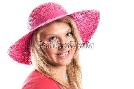 young blond woman with summer hat