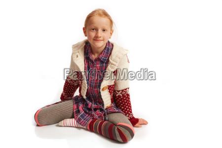 girl is sitting on the floor