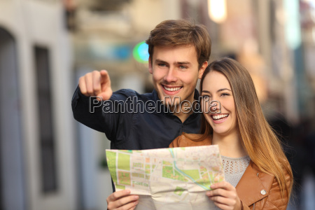couple of tourists searching a street