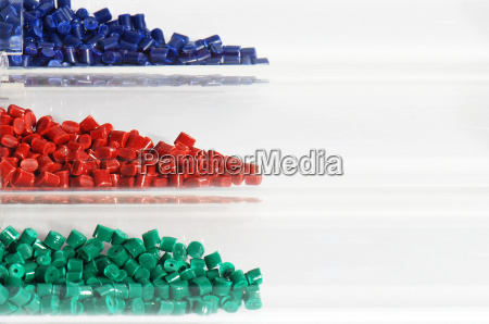 blue red green plastic granules in