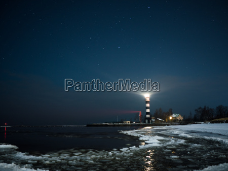riga lighthouse in a starry night