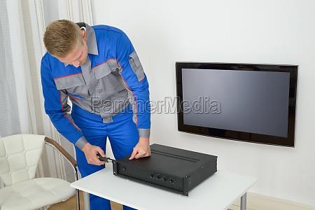 technician repairing amplifier