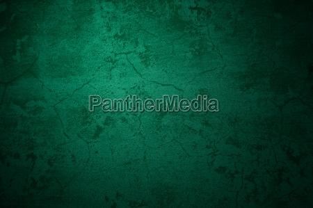 old dark green stone wall as
