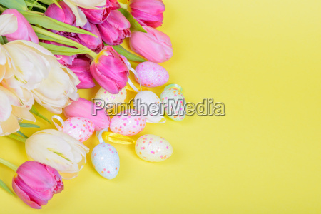 easter multicolored tulips and eggs