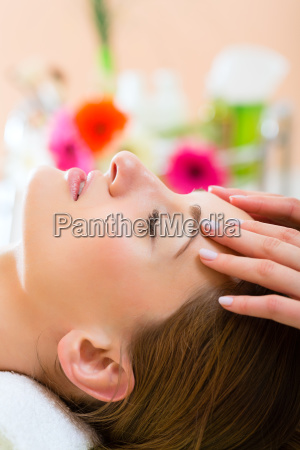 wellness woman receives head massage