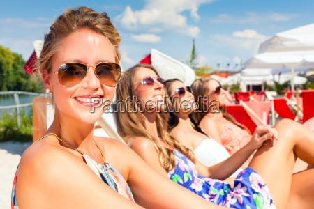 girlfriends basking in beach bar