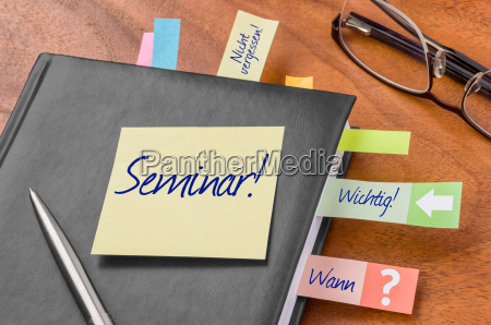 appointment calendar with sticky note seminar