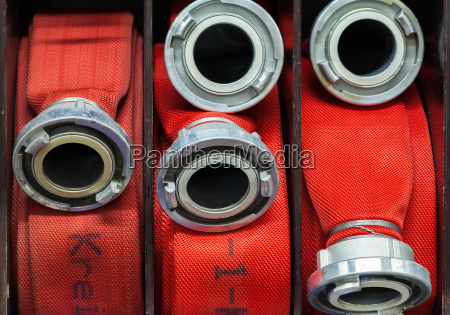 fire hoses rolled up