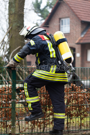 firefighter in action with oxygen cylinder