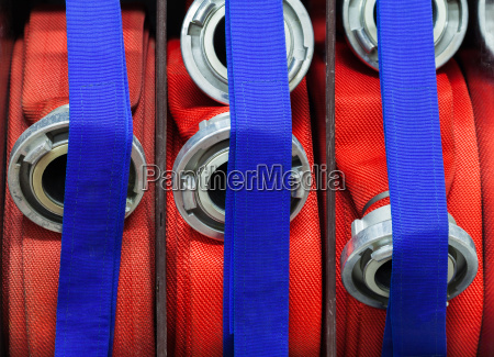 fire hoses rolled up with strap