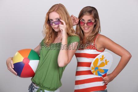 teenagers wearing beach wear
