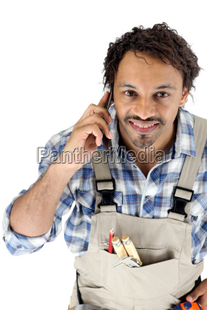tradesman talking on his mobile phone