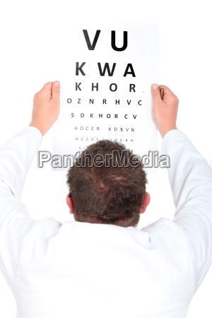 optician holding up an eyechart