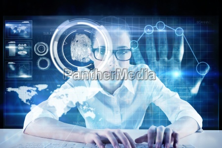 composite image of businesswoman typing on