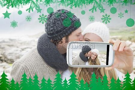 composite bild der hand haelt smartphone