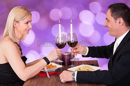 portrait of happy couple in restaurant