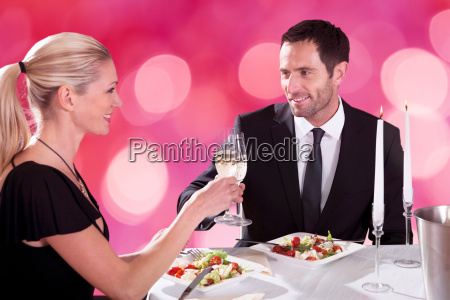 romantic couple toasting each other