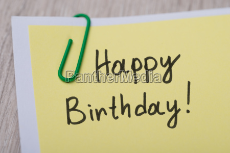 happy birthday written on yellow