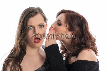girl telling a secret girlfriend