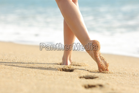 woman legs and feet walking on
