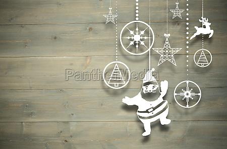 composite bild von weihnachtsschmuck haengen
