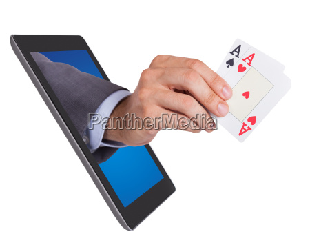 hand holding ace cards coming from