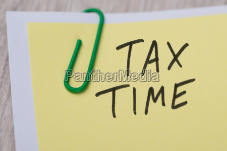 tax time written on yellow note