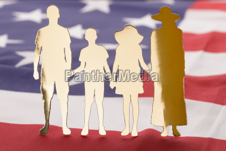 family paper cutout on us flag