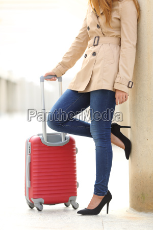 tourist woman legs waiting with a