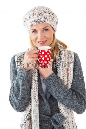 smiling woman in winter fashion looking