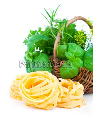 italian pasta with wicker basket green