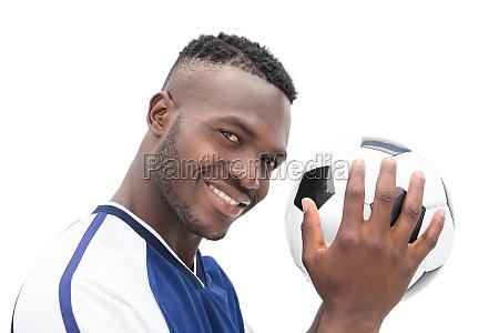 nahaufnahme portraet einer laechelnden schoenen fussballspieler
