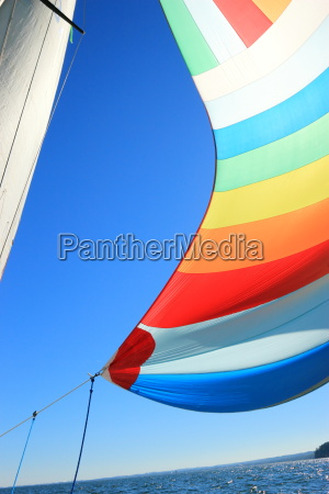 the wind has filled colorful spinnaker