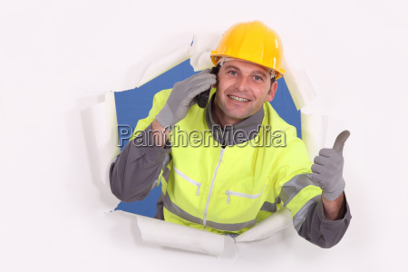 construction worker breaking through a barrier