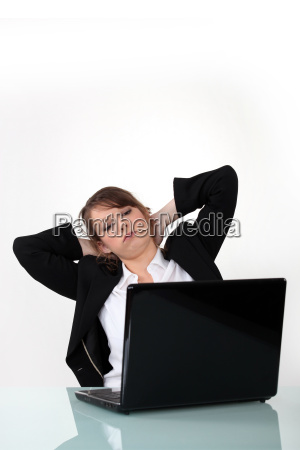 businesswoman with laptop relaxing