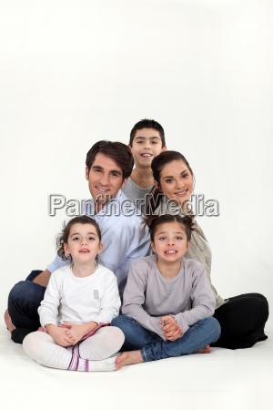 parents with three children in studio